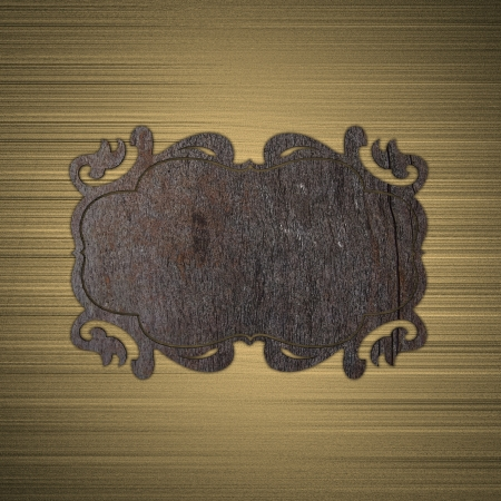 Wooden plate on a gold background photo