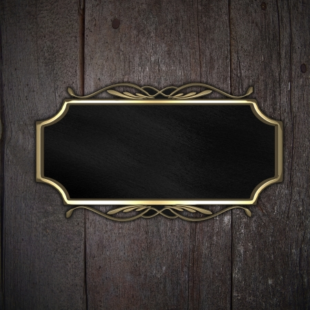 Beautiful pattern on a gold plate on a wood background Stock Photo