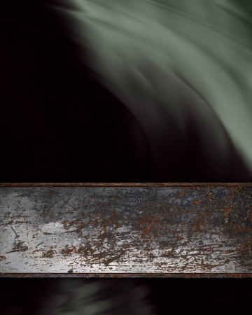 Black background with rusty metal plate photo