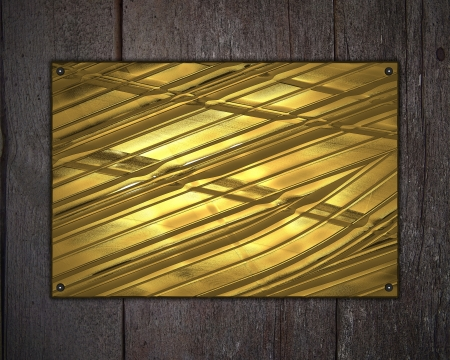 Gold plate on a beautiful wooden background photo