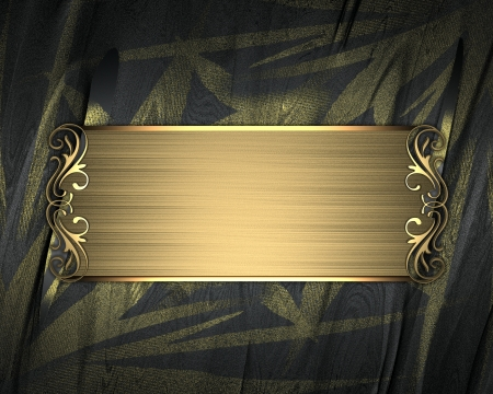The template for the inscription  Black background with gold flower, and with a gold nameplate  photo