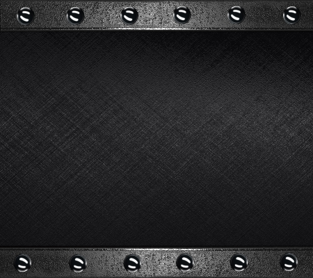 The template for the inscription  Abstract Black Background with metal plates at the edges with rivets  photo