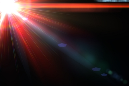 Design template - Star, sun with lens flare  Rays red of light on a  black background photo