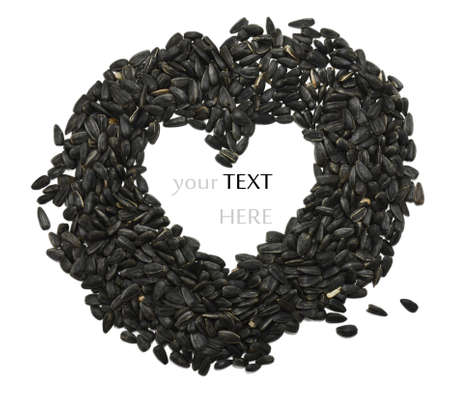 sunflower seeds in a heart shape. photo