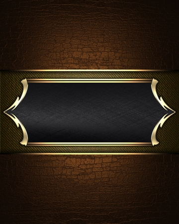 Abstract brown texture of a black name plate with gold patterns on the edges. photo