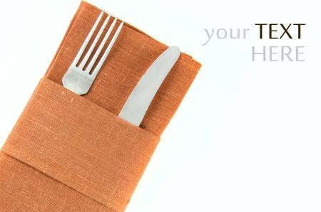 beautifully wrapped: Fork and knife beautifully wrapped in red cloth. Isolated on white background.