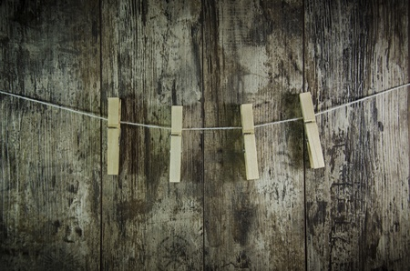clench: clothes-peg for linen with rope on retro old wooden background Stock Photo