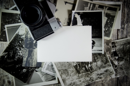 analog camera: retro still, old photos on wooden table background.