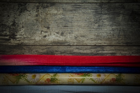 old wooden background with colored paper photo