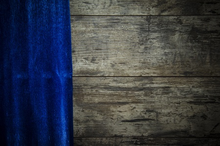 old wooden background with blue paper photo