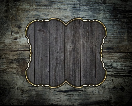 Wooden grunge texture with a nameplate of wood with gold trim photo