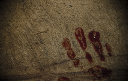 Grunge wooden background with a print of a bloody hand photo