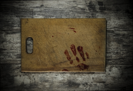bloody hand print: Grunge wooden background with a print of a bloody hand Stock Photo