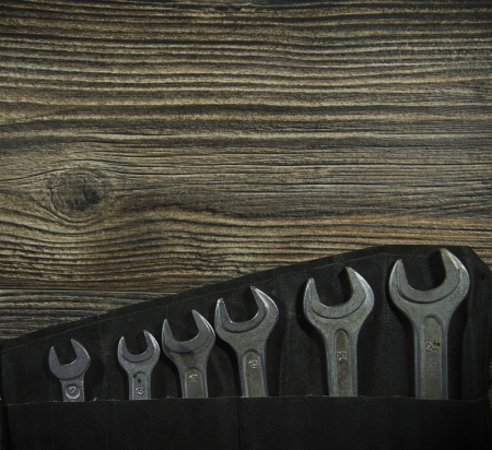 Set of wrenches on wooden background Stock Photo - 19120749