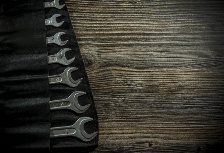 Set of wrenches on wooden background Stock Photo - 19120769