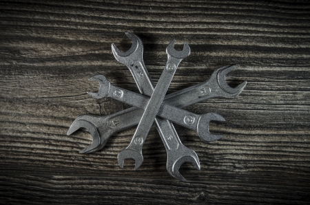 Set of wrenches on wooden background Stock Photo - 19120770