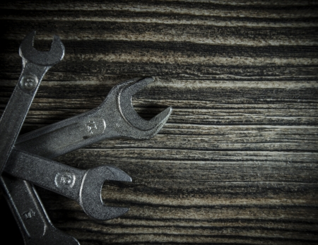 Set of wrenches on wooden background Stock Photo - 19120735