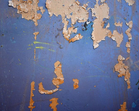 texture of rusty metal with an old peeling paint photo