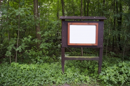 enquire: Information empty white billboard in the woods Stock Photo