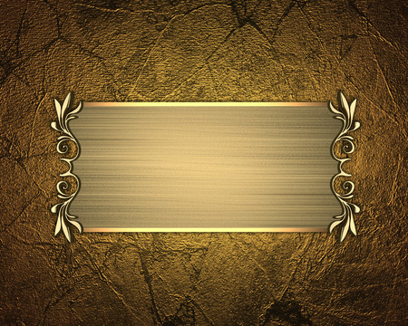 The template for the inscription. Gold Background with gold nameplate. Stock Photo