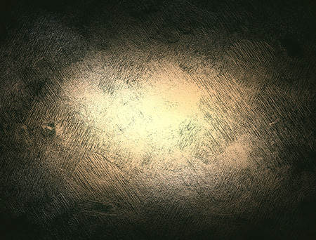 gold brown: gold brown background paper with vintage grunge background texture with black scuffed edges and old faded antique design has copy space for ad brochure or announcement invitation, abstract background