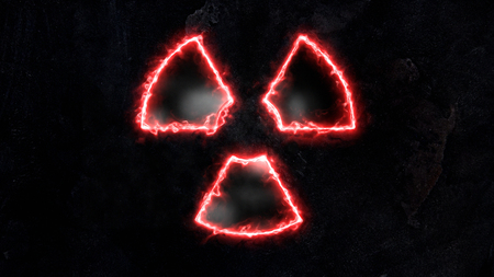 The sign of radiation glows with fire. Stock Photo