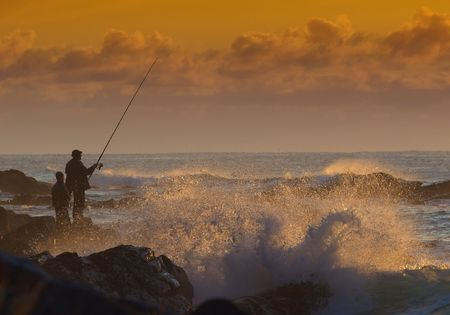 A rock fishing scene at sunrise. Stock Photo - 1006126