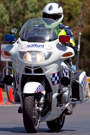 patrol: An Australian Police officer on his bike.