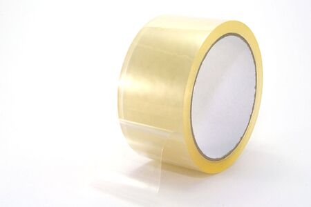 Aroll of clear packing tape, isolated on white background.