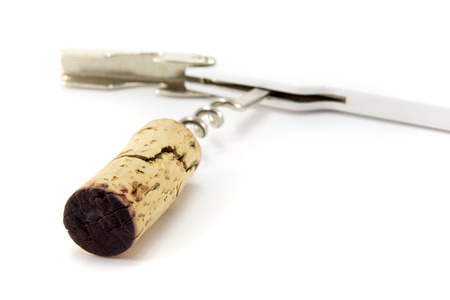 tainted: A corkscrew with used cork, isolated on white.