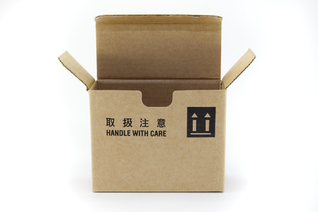 handle with care: A cardboard box with fragile symbol, isolated on white. Stock Photo