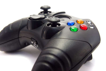 Close-up of a video game controller, focus on buttons. Isolated on white background.