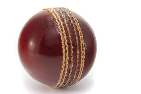 New red cricket ball, isolated on white background.