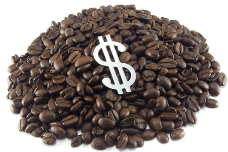 fairtrade: A mound of coffee beans on a white background, with dollar symbol on top.