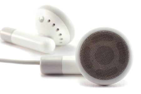 Modern portable audio earphones, isolated on a white background. Stock Photo
