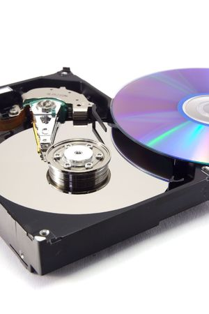 recordable: A hard disk drive an recordable DVD on white backgound.