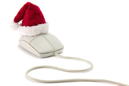technology transaction: A computer mouse with Santa hat on a white background. Stock Photo