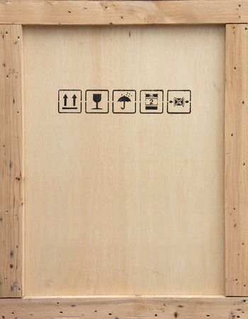 handle with care: A wooden packing crate with various packing symbols.