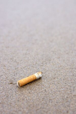 A used cigarette butt discarded on the pristine beach. Stock Photo - 2487305