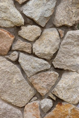 stacked stones: A stone wall background. Stock Photo