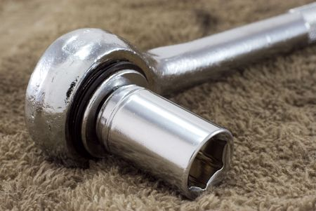 socket wrench: A mechanics socket wrench on an oily rag.