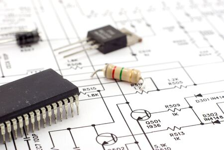 Electronic components on a schematic diagram background. photo