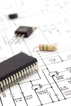 Electronic components on a schematic diagram background. Stock Photo - 3011880