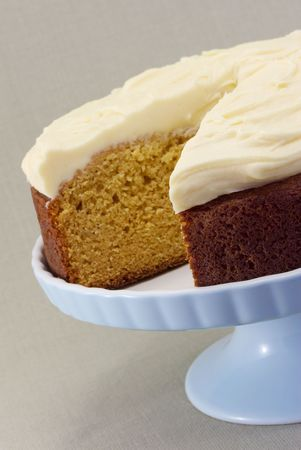 butter icing: A freshly baked caramel cake with creamed butter icing. Stock Photo