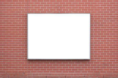A blank billboard on a red-brick wall. photo