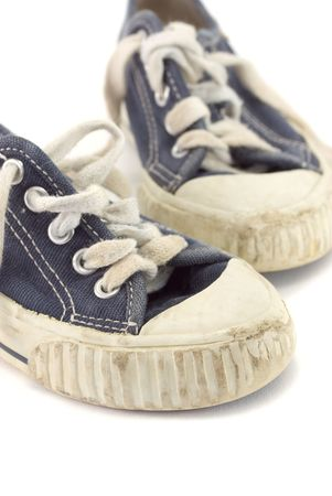 An old worn pair of childrens shoes. photo