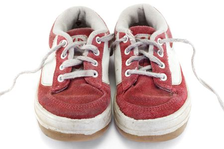 scuff: An old worn pair of childrens sports shoes. Stock Photo