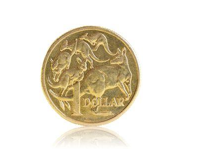 A well worn Australian dollar, isolated on white. Stock Photo