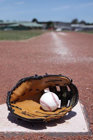 A baseball glove and ball. photo