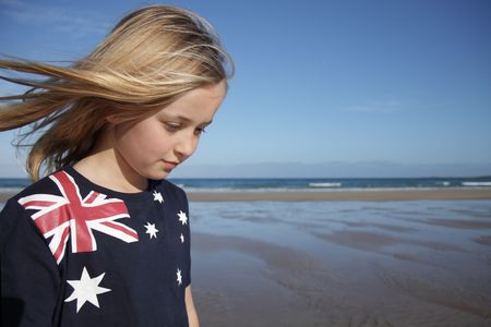 A young girl wearing an Australian flag t-shirt at the beach. photo